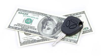 Photo of car keys and a hundred dollar bill